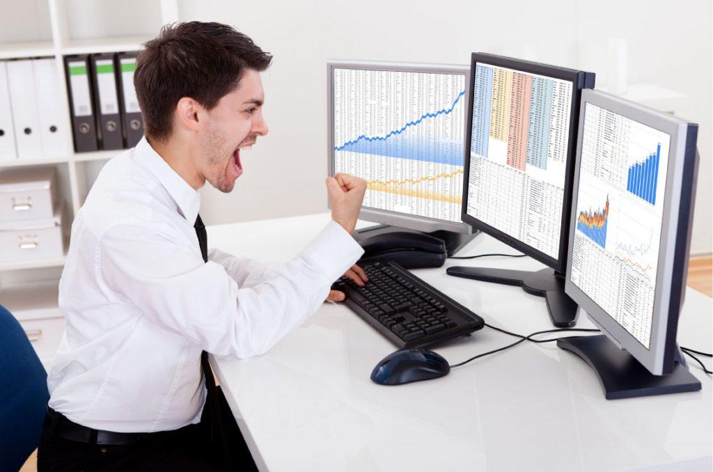 bigstock-Stock-Broker-Trading-In-A-Bull-54559502