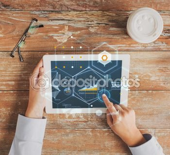 depositphotos_73566893-close-up-of-hands-with-tablet-pc-and-virtual-graph